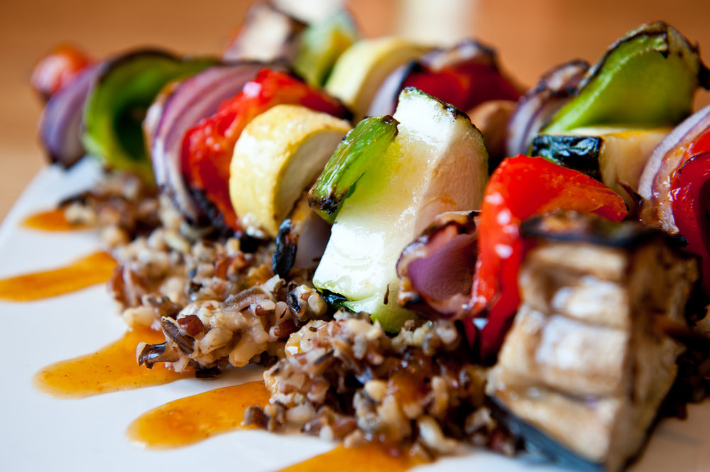 Both of these entrees feature a fantastic mix of veggies that happen to be in peak season right now: broccoli, eggplant and summer squash. If gluten isn't your thing, our vegetarian kebob offers the same flavors served over a whole grain and brown rice medley.