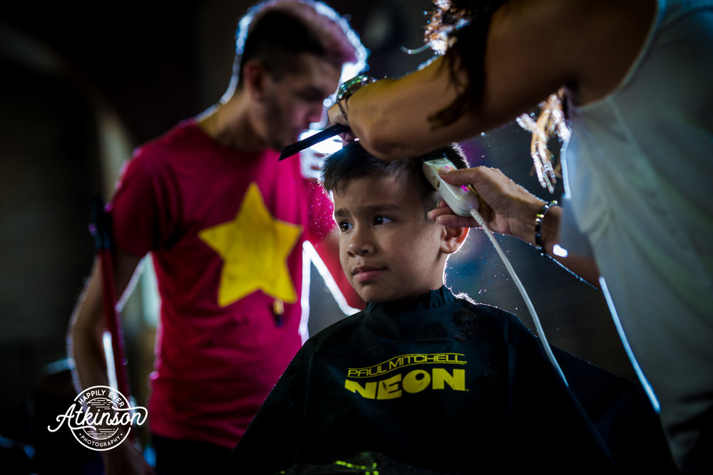 Little boy gets a haircut