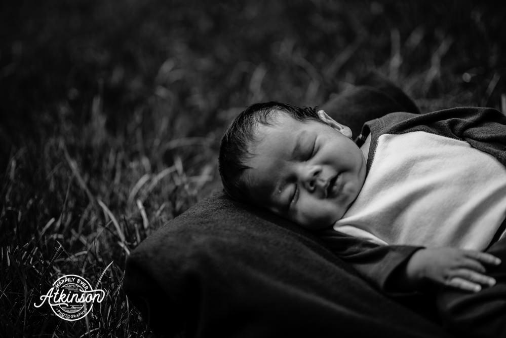 Newborn portrait in grass