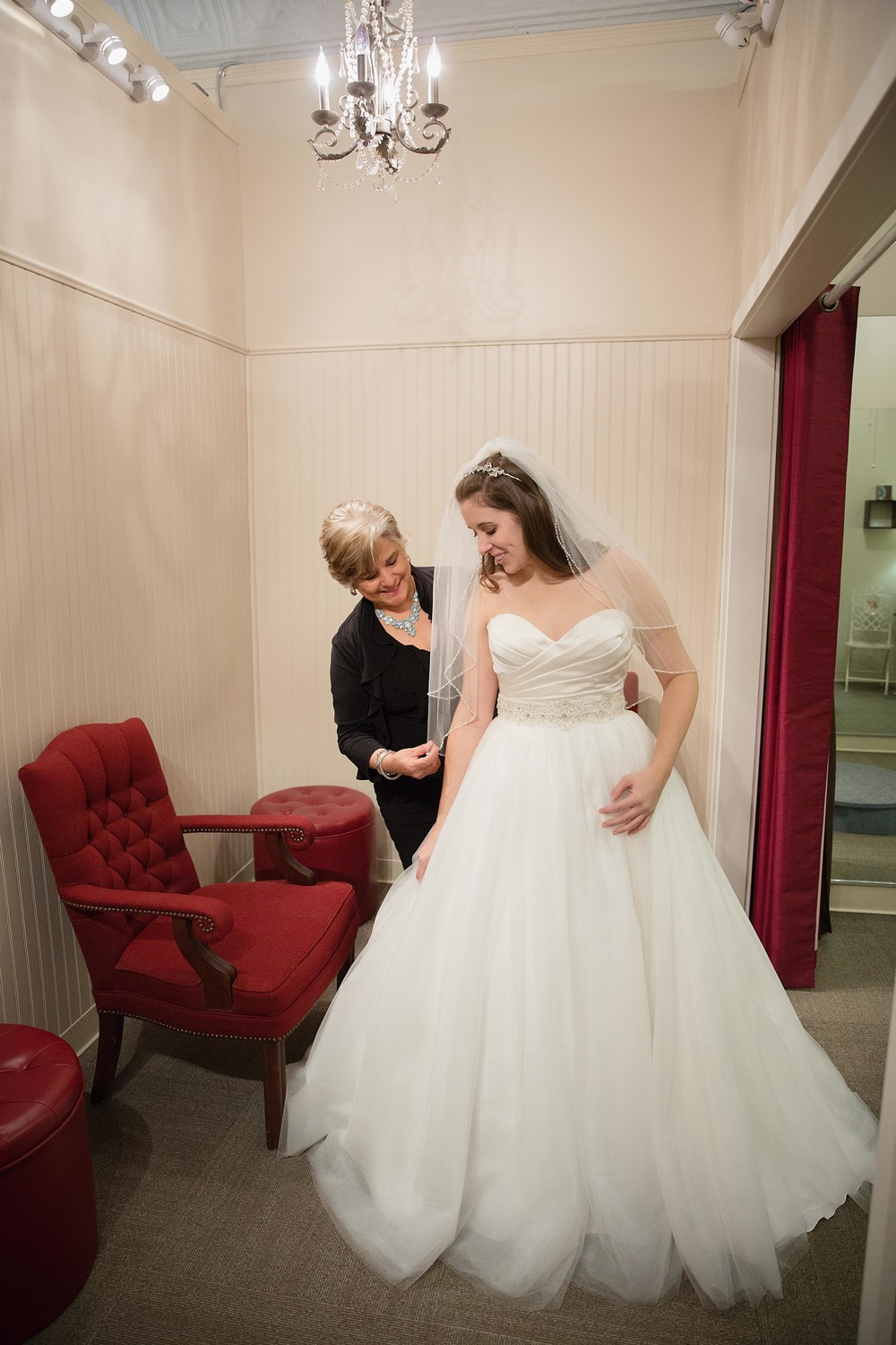 You will then move to a spacious, private area, along with any family or friends accompanying you, where you will be assisted in trying on the gowns you've selected until you find the perfect one!