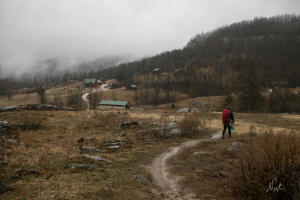 Kayla walked back to the camp. It was raining.