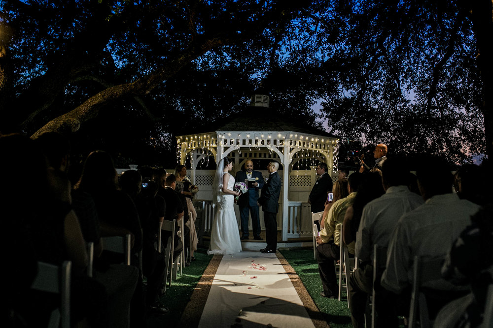 Gaby and Juan in the ceremony during beautiful sunset t Jupiter Garden Event Center, Dallas, Texas.