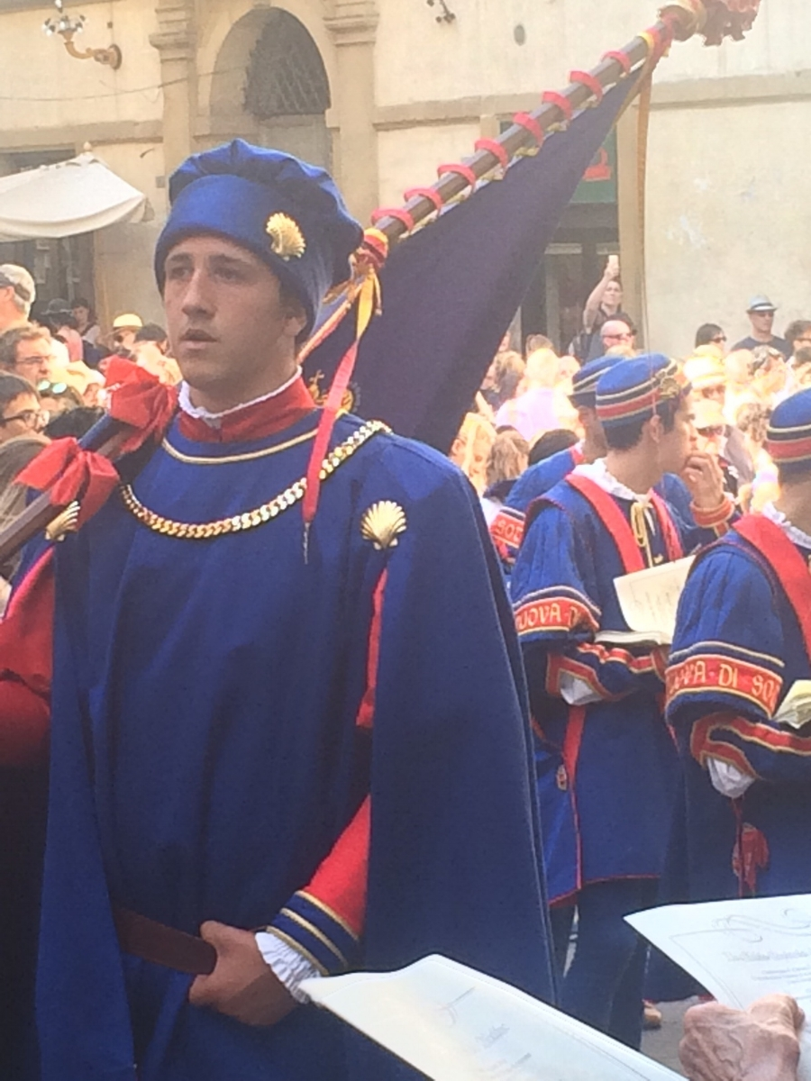 Palio is starting...men in these blue outfits and tights with flags and drums marched around the city all day long with people following them through town.  It was a festive first day in town for me.