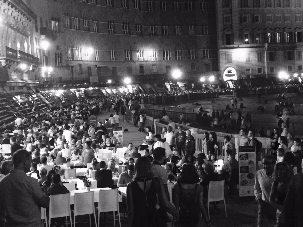 Piazza del Campo at night. Dirt covers the ground and the restaurants set their tables on it.  I love walking on the dirt for some reason...I find it comforting.