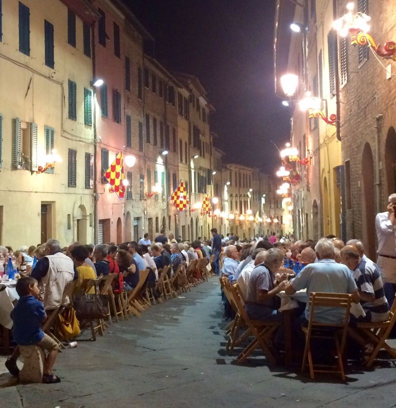 Contrada dinner on Via San Marco, August 15, the night before Palio.  This is the street where I am currently living.