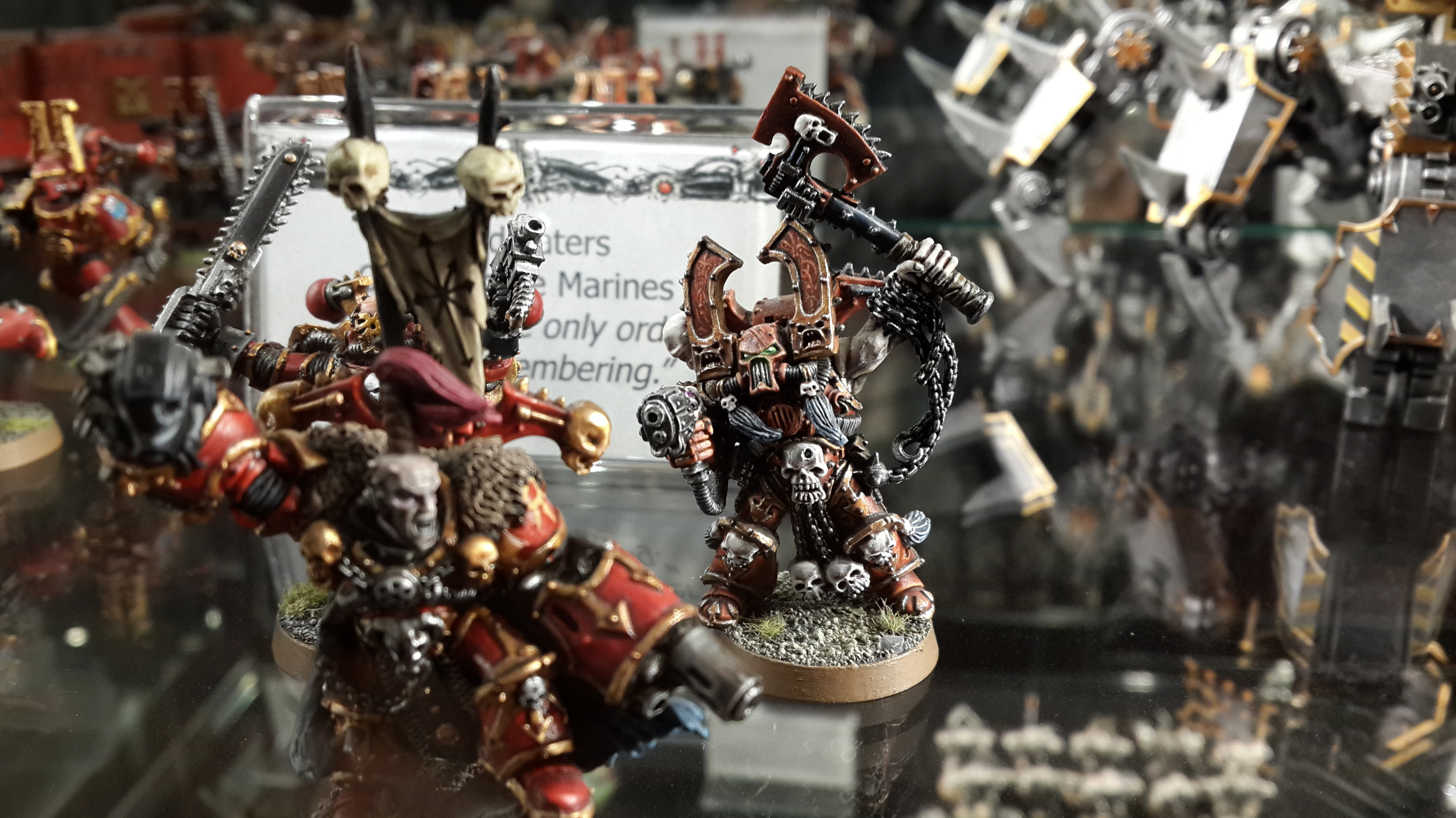 Kharn: 'You have a combi-melta, you moron, why are you throwing a helmet at them? Oh whatever... KILL! MAIM! BURN!'