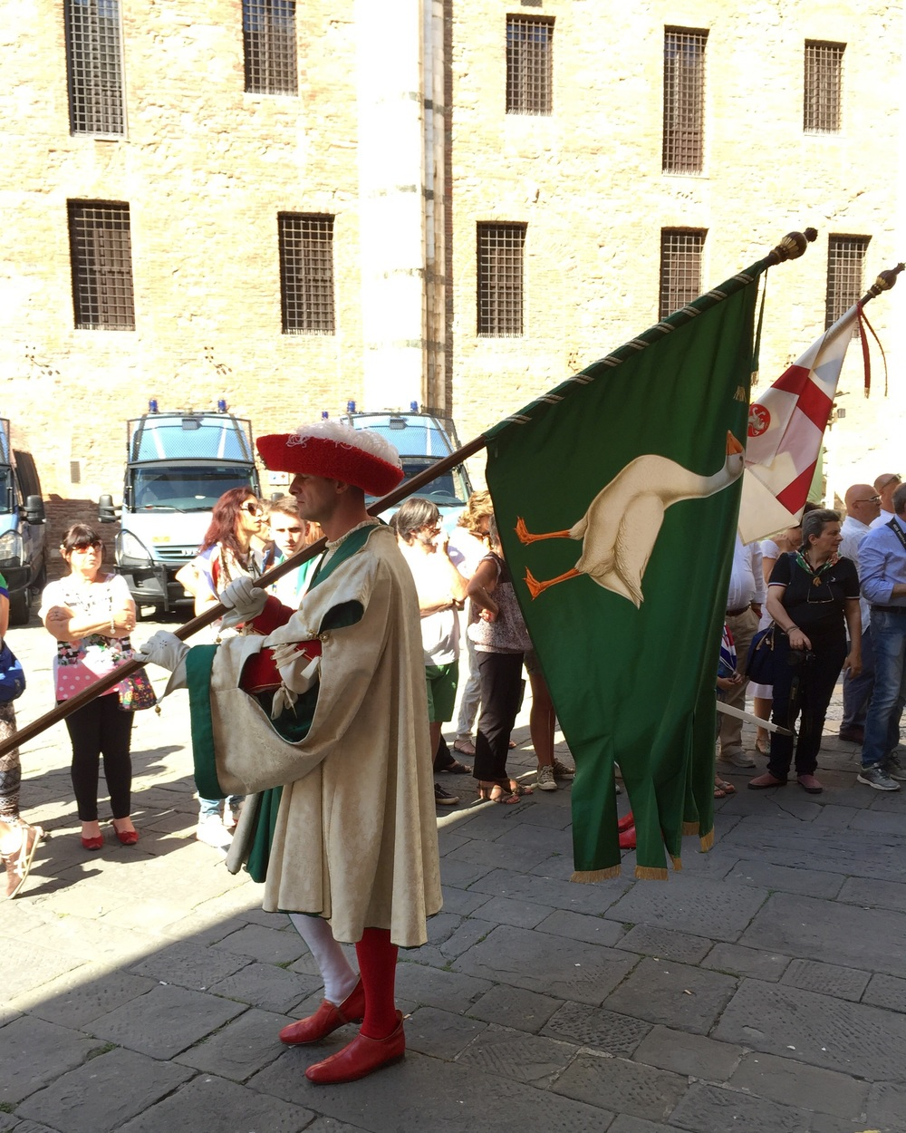 Pre race parade through the streets of Siena. Oca banner!