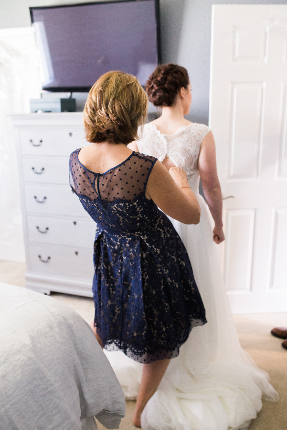 Coohills Wedding Photographer - putting on wedding dress