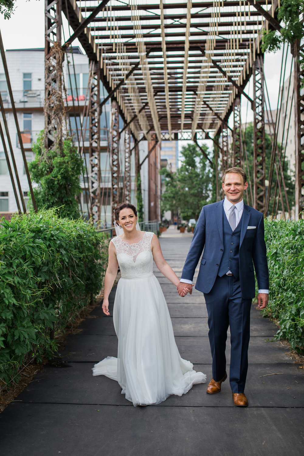 Coohills Wedding Photographer - happy couple on bridge in Denver