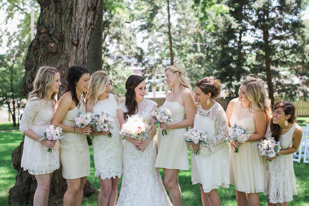 bridesmaids in mismatched cream dresses