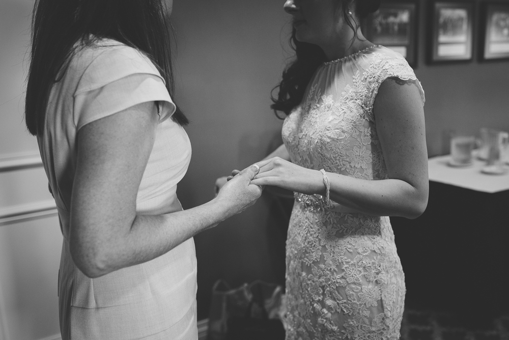 bride and mom moments before walking down the aisle