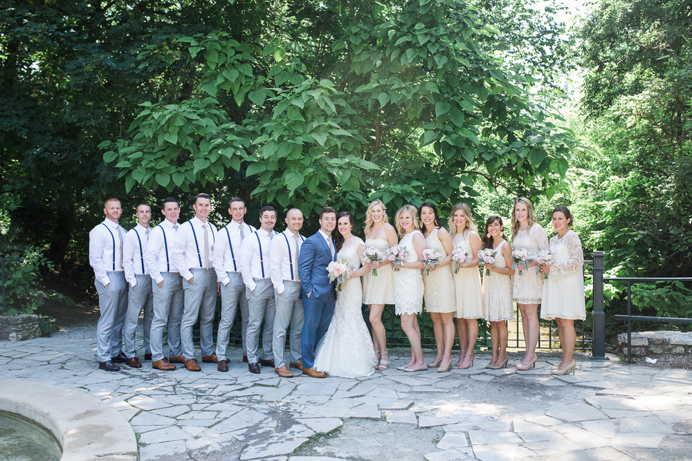 cream and grey large wedding party