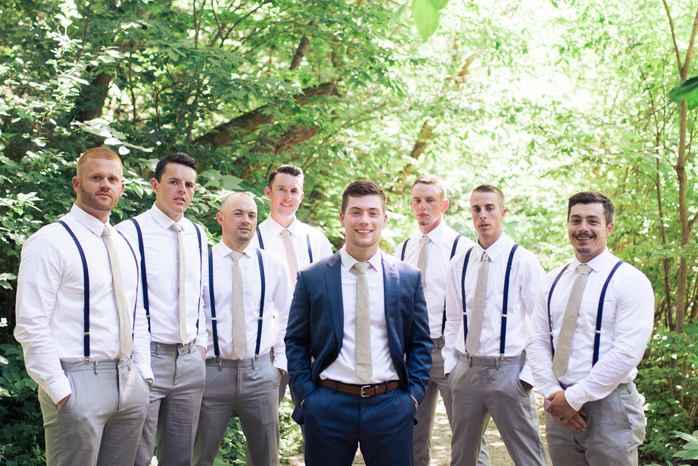 blue suit and grey pants with suspenders groomsmen