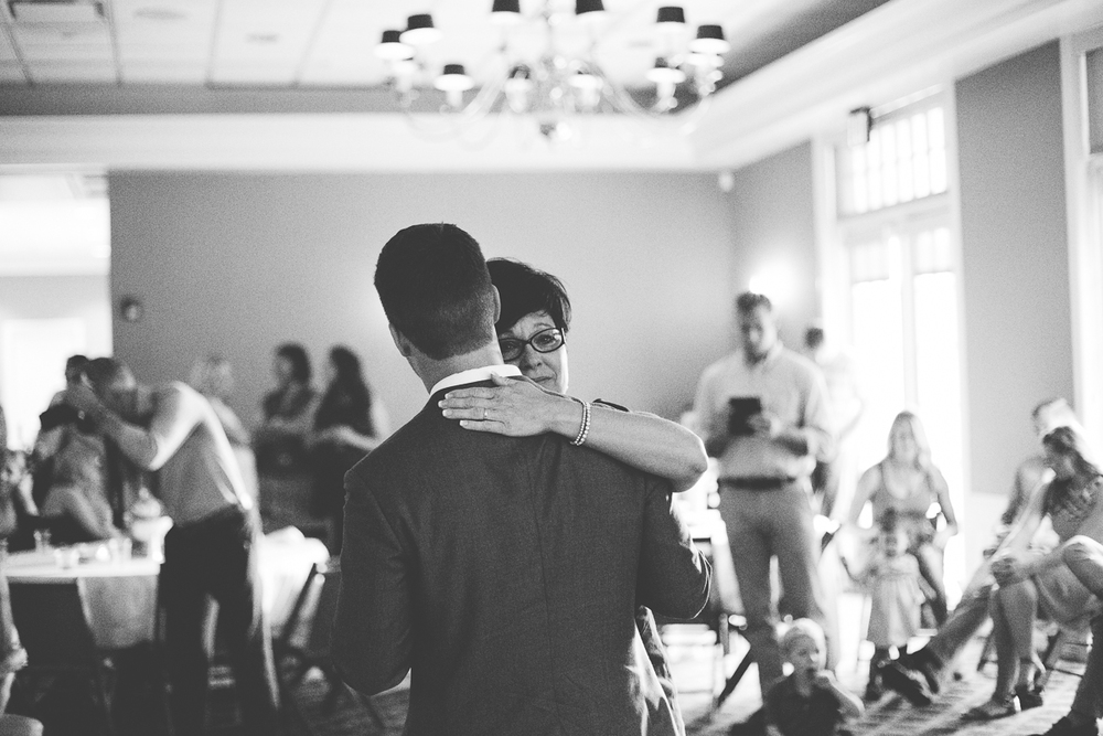 mother of the groom dancing with her son