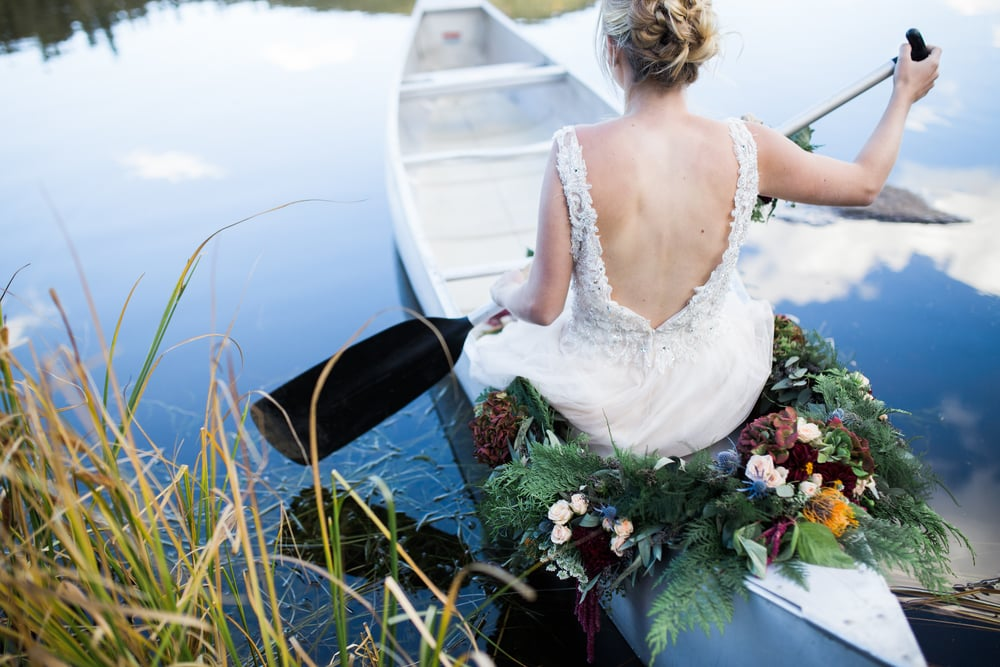 Colorado Mountain Wedding Photographer - bride on canoe