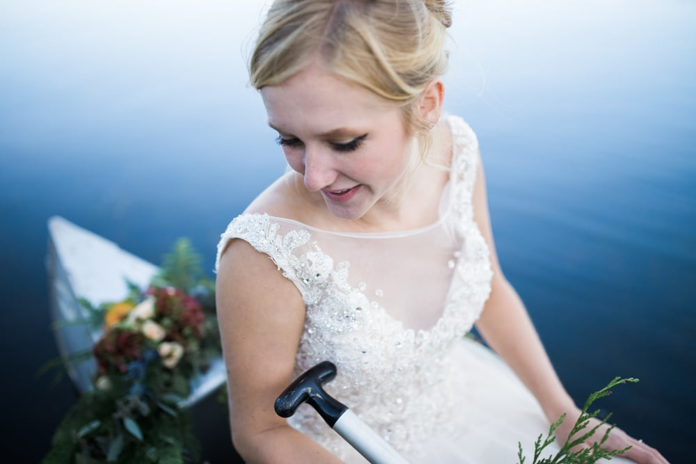 Colorado Mountain Wedding Photographer - bride with canoe paddle
