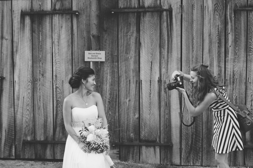 Jenna and I getting her bridal shots (and probably giggling about my awkward squatting pose)