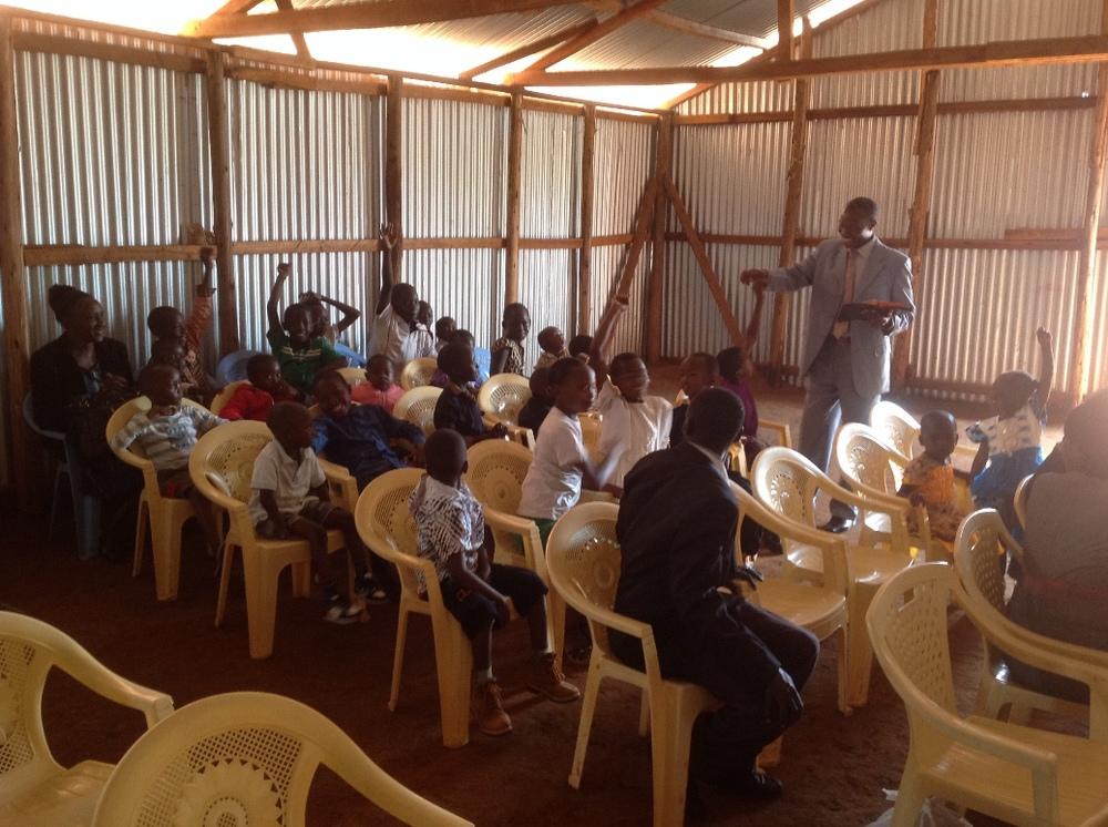 Pastor George teaching Sunday School children in Kitale