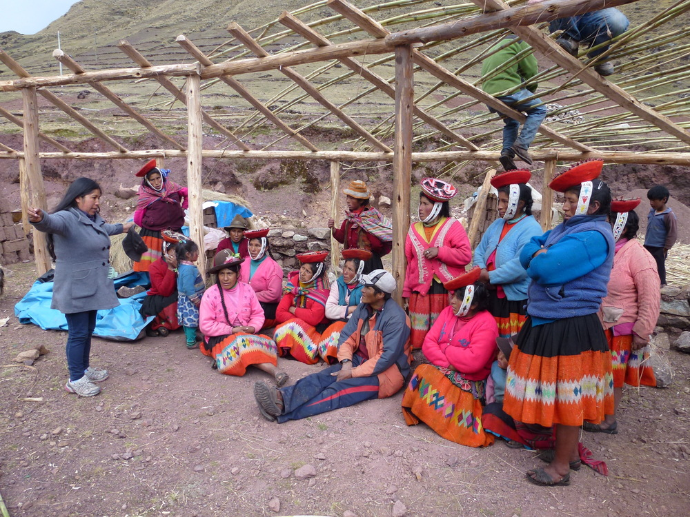 A meeting between Estela, one of the Awamaki seamstresses, and some of the women of the Patacancha weaving cooperative.