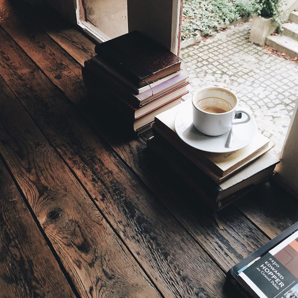 designcollector: Photo by @jasminetartine (http://dcult.net/1MMuDO0)Books & coffee… Is there anything better to soothe the soul with? Home life //