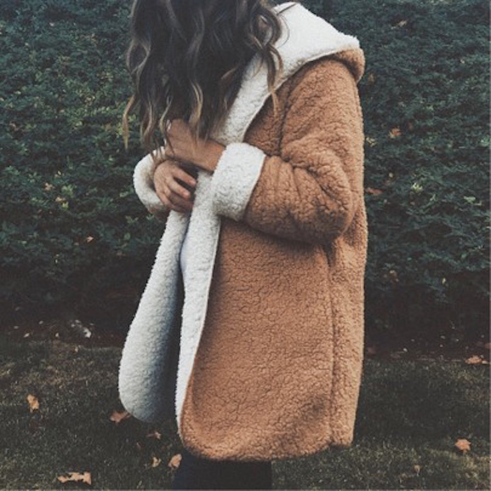 COVET - The weather's changing and the world feels a little scary. Hug your loved ones and snuggle up in styles that make you feel warm and cozy. This reversible coat is nostalgic and trendy all at the same time. Wear it to/from sweat sessions, après ski, by the fire and out to brunch, Shop it here.
