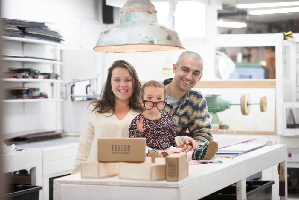 Sydney and her husband Chris in their home studio with daughter, Kaia.