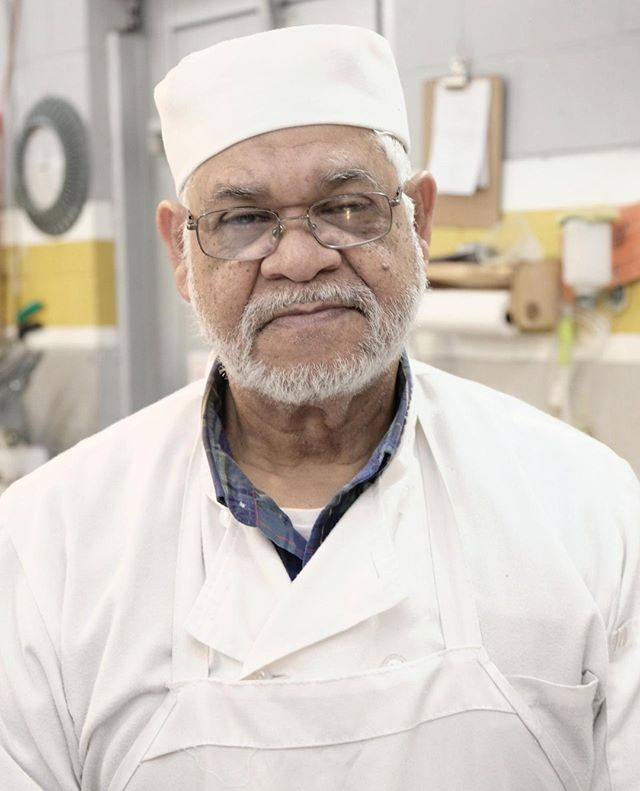 Luis Rodriguez and his wife Ramona moved from the #DominicanRepublic over 40 years ago and built a butchering business from the ground up. His original shop was on Houston Street and called Los Cuñados, but in 1997 he moved to #essexstreetmarket to open Luis Meat Market. They offer quality, affordable cuts of beef, pork and poultry, as well as harder-to-find specialties like oxtail, rabbit and goat. When he's not working the counter, Luis likes to play Barry White and enjoy a glass of wine and alpine cheese! #seamosmucho #carniceria #loisaida