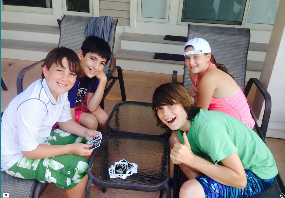 four out of five of the miller & friedlanderkids playing cards