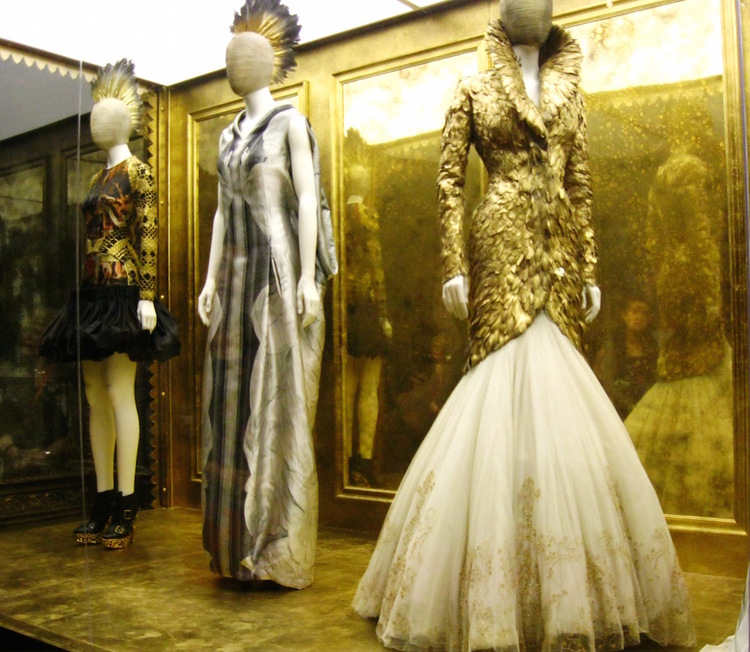 On the right, the inspirational Alexander McQueen feathered coat