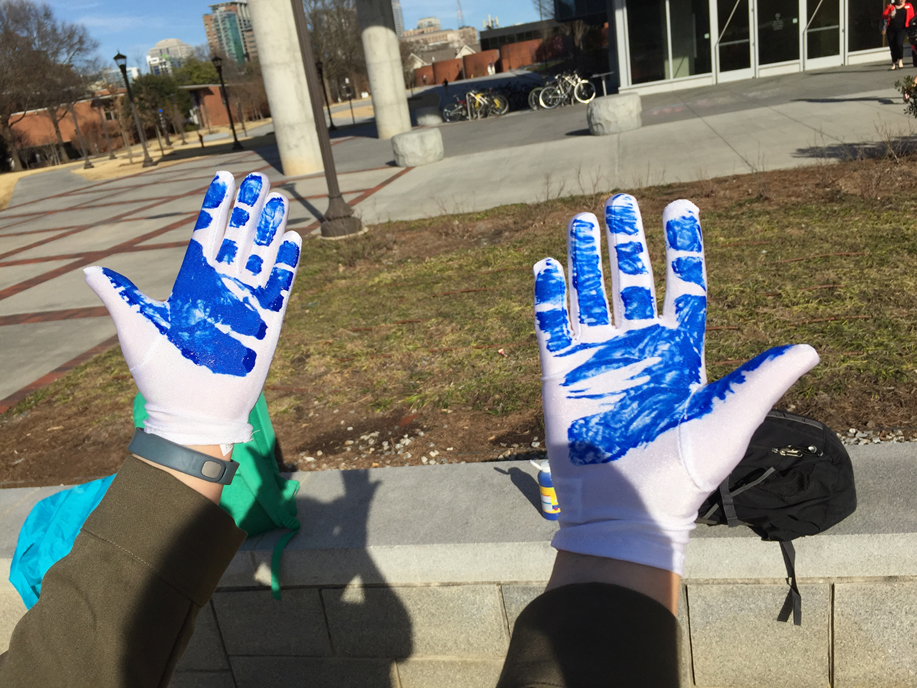 Painted gloves show pressure points when swinging the bat