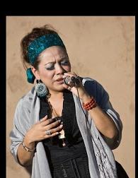 """""""   Singing canciones de mi tierra!""""    -   Gloria"""