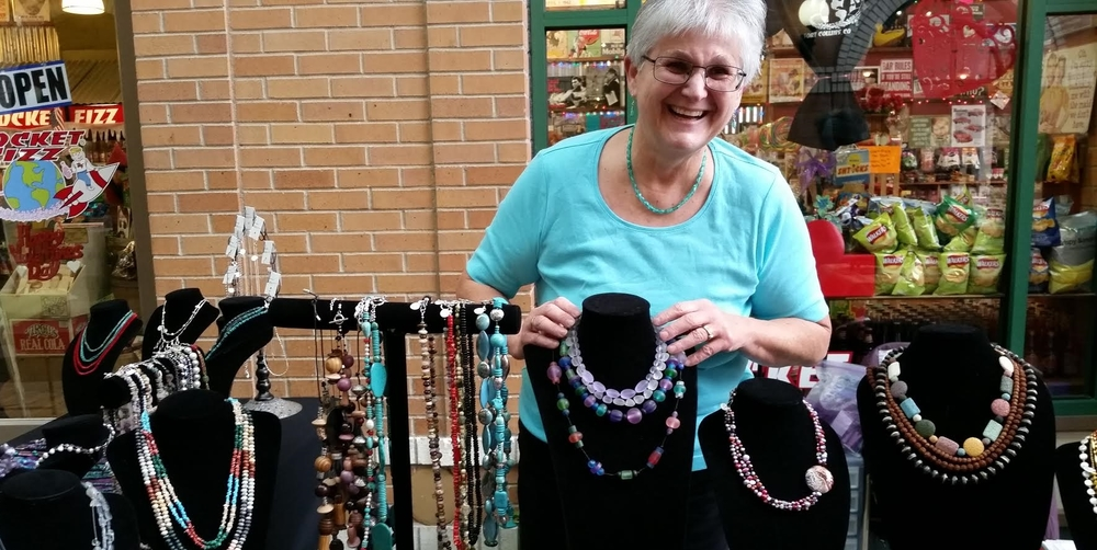 """""""I make jewelry, and I love when someone chooses just the right piece for themselves and I get to see their eyes light up. For me, the interaction with the customer is almost as much fun as designing and creating the jewelry. """"    -  Valerie"""