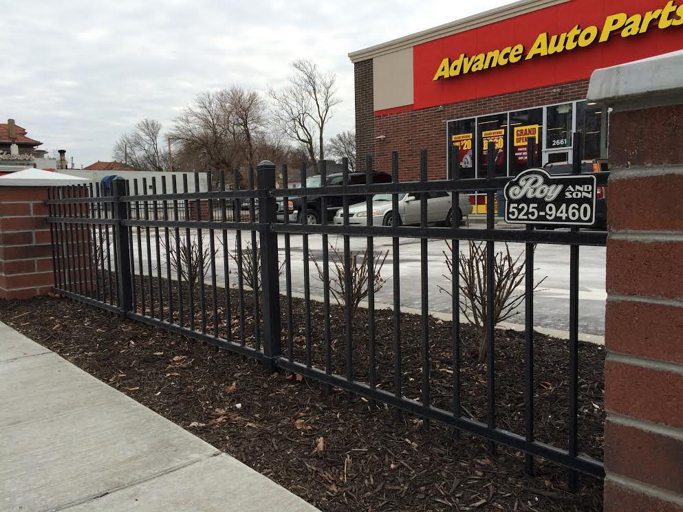 Roy and son fencing fence at advanced auto parts.jpg