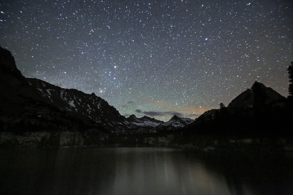 The night sky over Blue Lake within Sabrina Basin