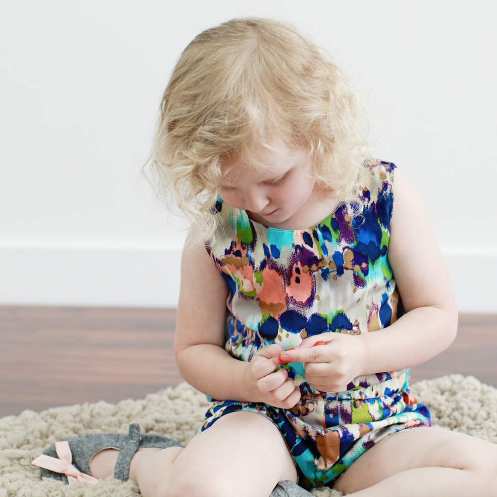 Charlie's romper by Glitter+Wit, shoes by Nori Brand