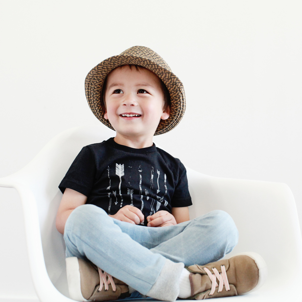 Lucan is wearing a hat by Gap, arrows tee by Spath Designs, pants by JR Cooper and shoes by Carters.