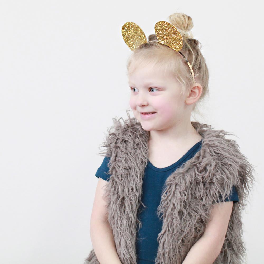 Fur vest by Nori Child, leotard by Alice&Ames