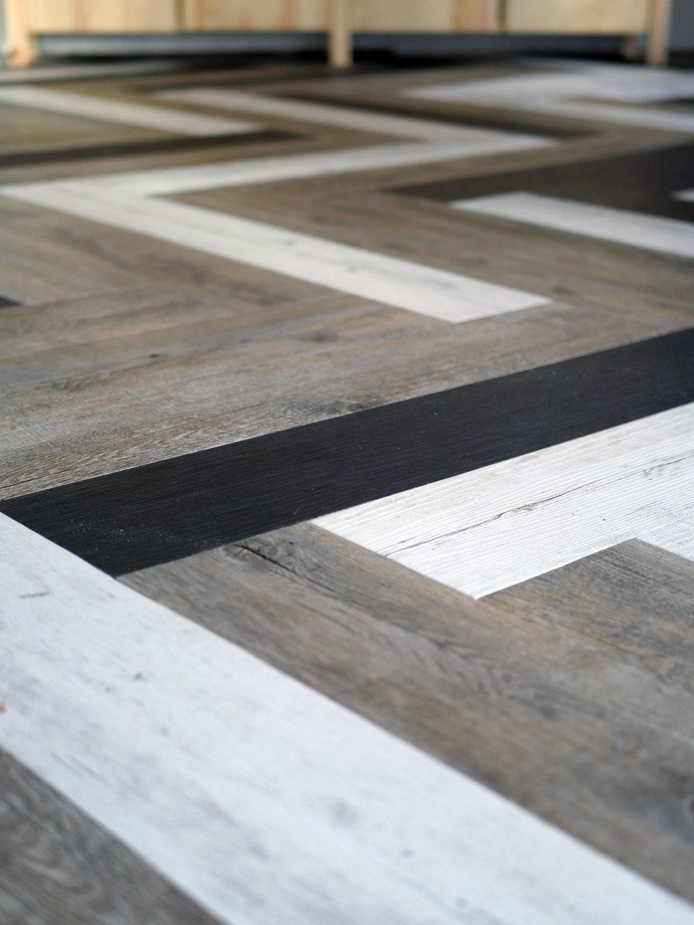 Oh yes she DIYd - Herringbone floors with Vinyl Stick Down Planks