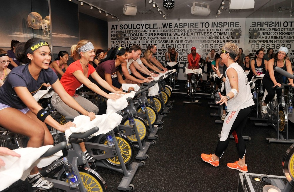 Master Instructor Stacey Griffith teaches a packed studio photo by SoulCycle