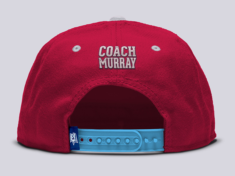 Coach's ball cap back with embroidered patch and sewn garment tag