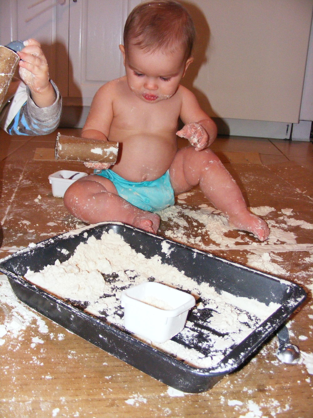 She's been enjoying some sensory play of late. This is moon sand (flour/vegetable oil)