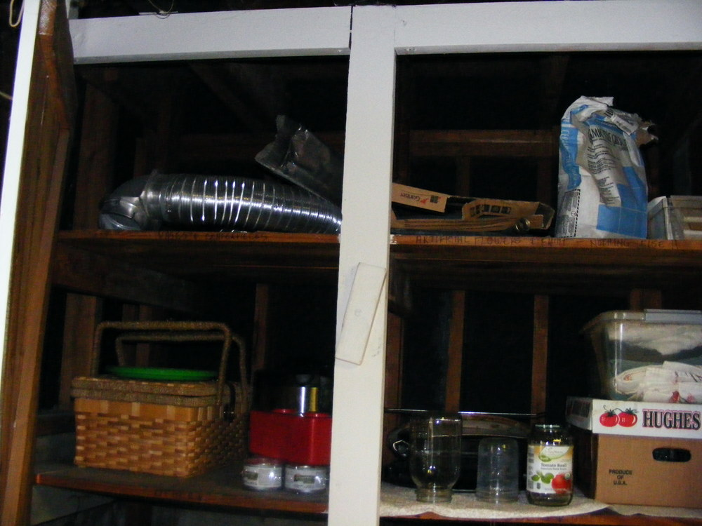 The top shelf was full of stuff from the previous homeowners. Everything up there either got donated or tossed. The second shelf held a random assortment of items.