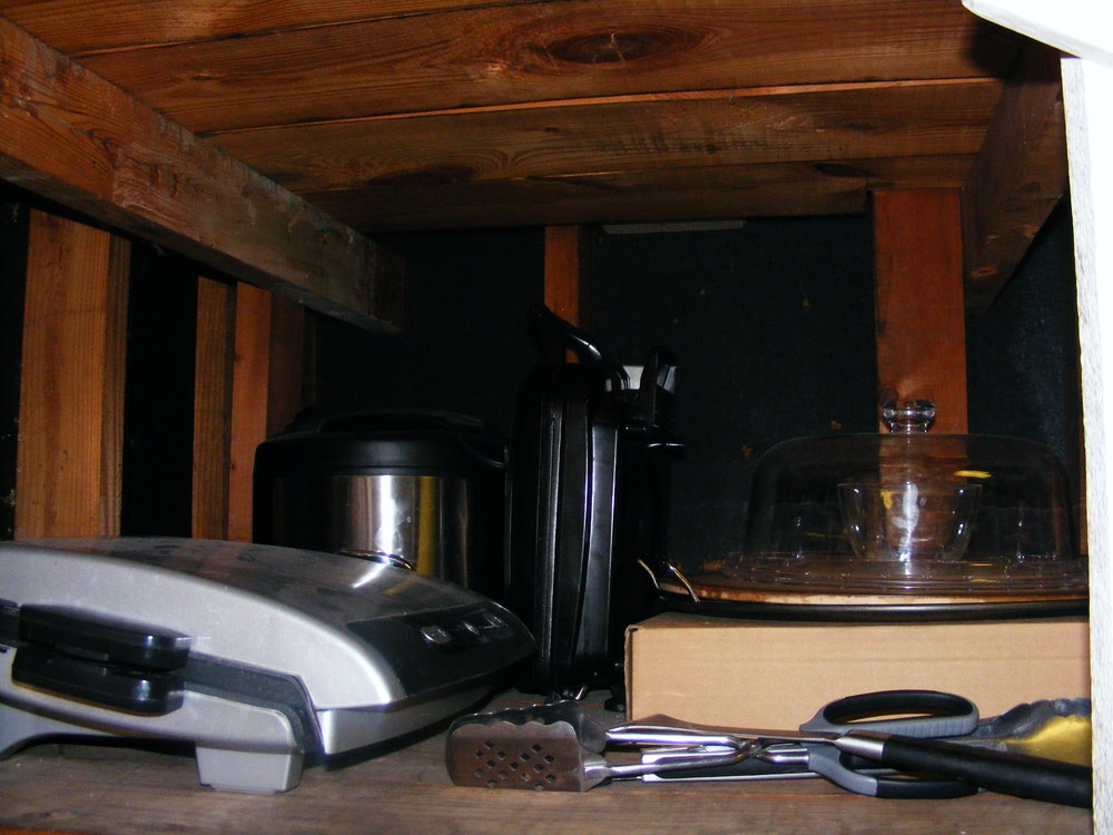 The second shelf now holds the small appliances that we use more frequently.
