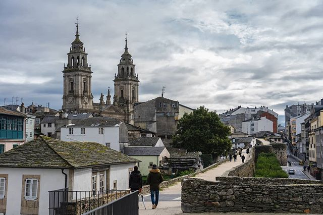 I took this photo in Lugo, Galicia, north-western Spain a couple weeks ago. You can walk around the entire wall, which is quite the trip. It envelopes a bustling inner village which comes alive at night (as does most of Spain). In this photo you can see Saint Mary's Cathedral, erected early in the 12th Century. . . . . . . . . #wandrlustr #wanderlust #icu_architecture #jj_architecture #creative_architecture #arkiromantix #tv_architectural #archimasters #excellent_structure #arquitecturamx #diagonal_symmetry #streetphoto #streetlife #streetportrait #documentary #lensculturestreets #urbanphotography #streetphotographer #Galicia #lensculture #visitspain #icu_spain #ok_spain #españa🇪🇸 #instaspain #espana #sonyimages #sonyalpha #sonyalphasclub #sonyphotogallery