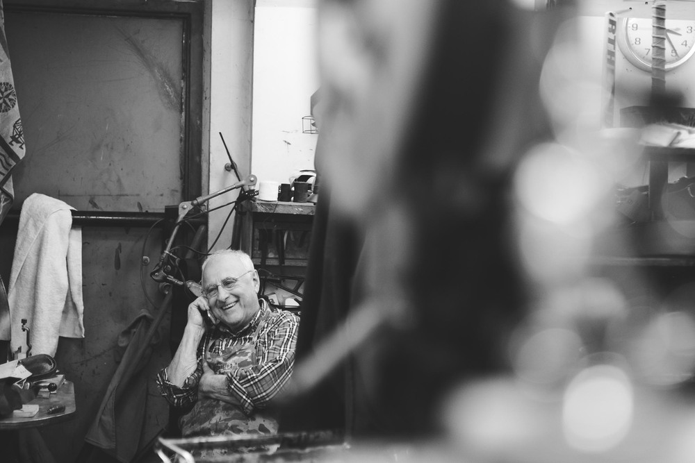 George Fabian, owner of Park Street Shoe Repair, pauses for a moment to enjoy a phone call at the end of the day. The business, started by his Sicilian father in the 30's, has operated at it's current location for the last 55 years.