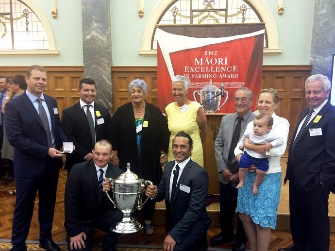 Ngāi Tahu Farming staff in Wellington for the announcement of Ahuwhenua finalists. Back row, from left: Ngāi Tahu Farming CEO Andrew Priest, General manager, Ngāi Tahu Farming Dairy, Shane Kelly, Mana Whenua Clare Williams, Stakeholder Engagement Specialist Kim Manahi, Mana Whenua Lik Dawson, Catherine Dawson and baby Taituha, Ngāi Tahu Farming Board Chair Gill Cox. Front row, left, finalist Rod Lamb, Te Ahu Patiki and finalist Hemi Dawson, Maungatere.