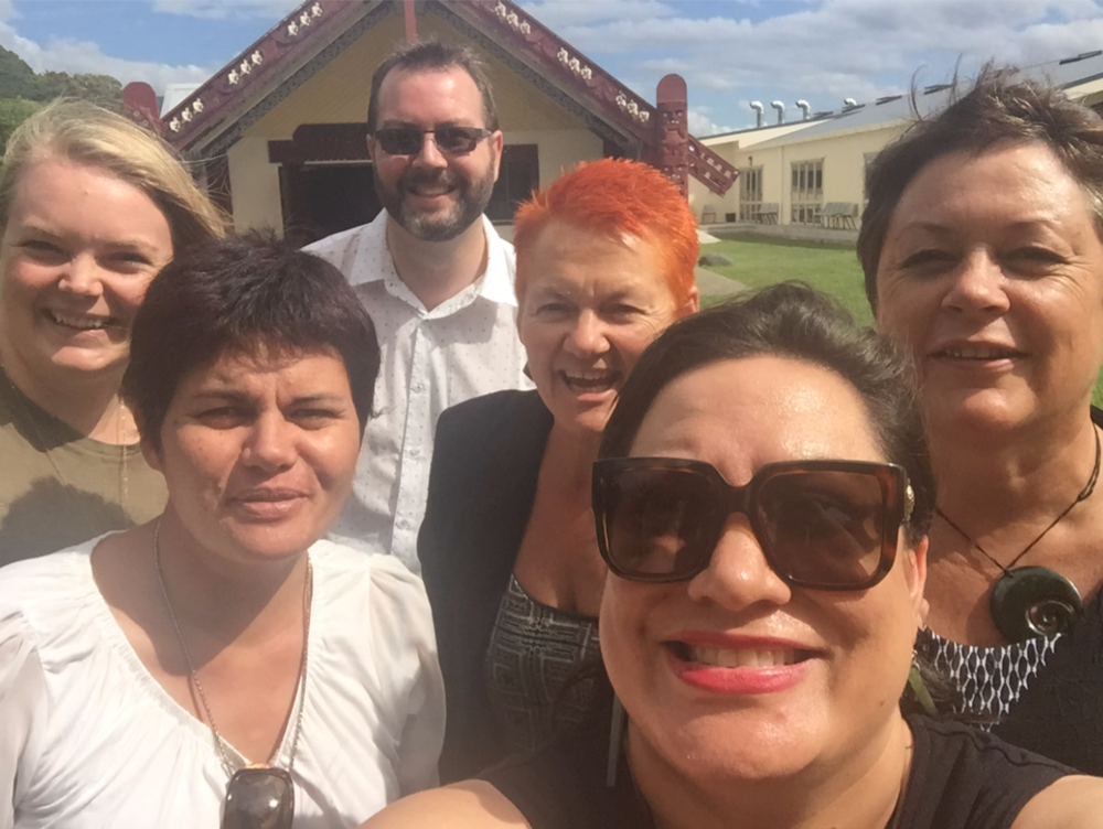 Nearly all the team in front of Whakatū Marae.   From left to right: Alice Matheson (Policy Advisor); Gina-Lee Duncan (Contract Advisor for Te Ha o Kawatiri); Haydon Richards (Innovations Director); Helen Leahy; Maania Farrar (Commissioning Manager) and Juli Tyler (Office Manager).