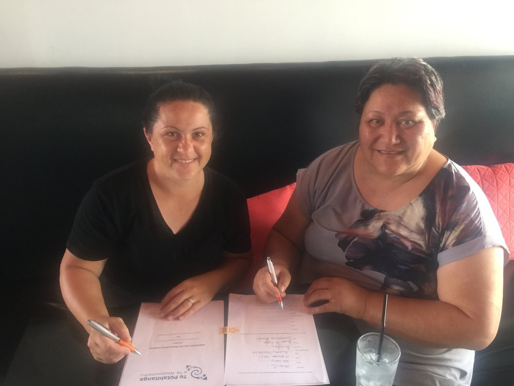 Milly Finlay and Sue Parish from Rangitane ki Wairau Ahi Kaa signing their Agreement.