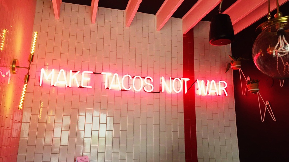Make Tacos Not War - Perfectly said via neon at Tacos Tu Madre