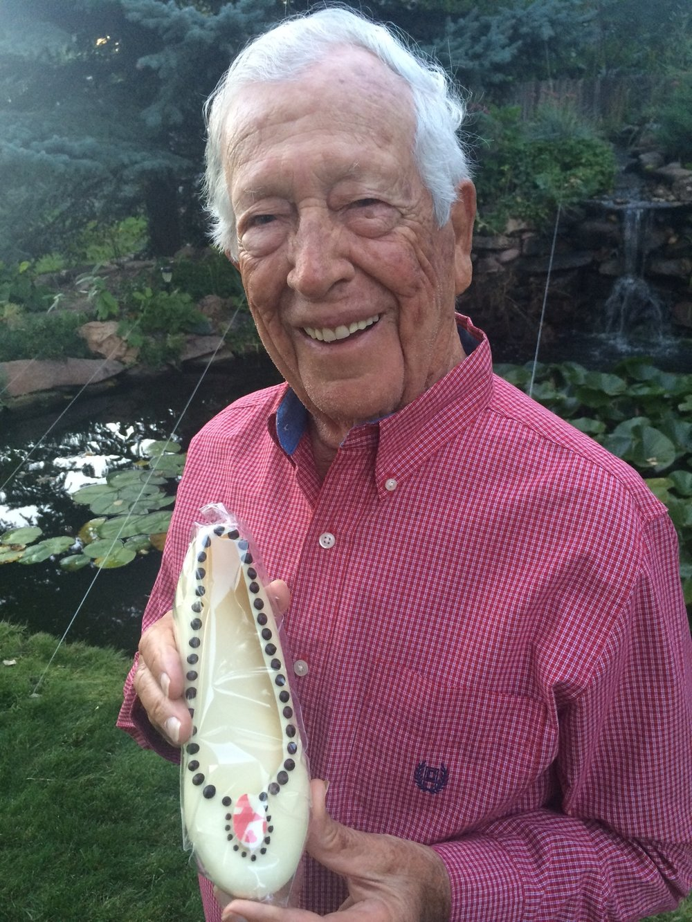 "After the war, Joe became a world-class shoe designer in New York. Here's Joe, 9/16/2016, enjoying a ""sweet"" chocolate shoe from Gayles Chocolates. (Learn more-#1 Amazon Best seller: Auschwitz #34207 Joe Rubinstein Story)"